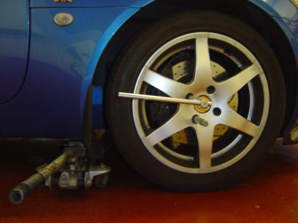 3. Loosening Road Wheel Bolts.JPG